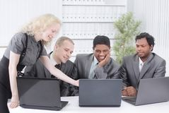 Business team discussing business issues sitting at their Desk. Photo with copy space stock image