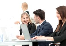 Business team discussing new information , standing in front of the open laptop stock photo