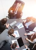 Business team discussing in office financial issues. Business team at a briefing discussing financial charts royalty free stock photos