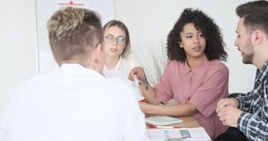 Business team discussing over document at office stock footage
