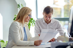 Business team discussing papers at office table Royalty Free Stock Photo