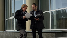 Business team discussing papers outdoor stock footage