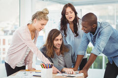 Business team discussing while pointing at diagram Royalty Free Stock Photography