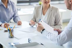 Business team discussing report at office royalty free stock photography