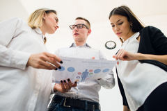 Business team discussing some charts. Bottom View Royalty Free Stock Photo