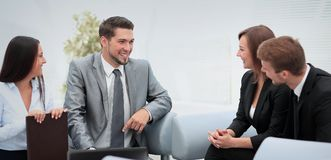 Happy business people talking on meeting at office Stock Photography