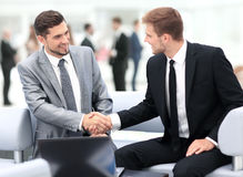 Business team discussing together plans. Business people shaking hands during a meeting royalty free stock photos