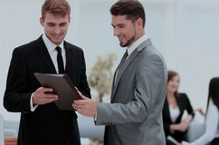 Two successful business partners discussing documents and ideas. Business team discussing together business plans Stock Image