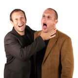 Business Team In A Dispute. Two businessmen are having a dispute. One is strangling the other one Stock Images