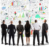 Business team drawing a new complex project. On wall stock image