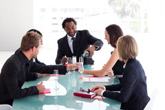 Business team drinking champagne in a meeting Royalty Free Stock Image