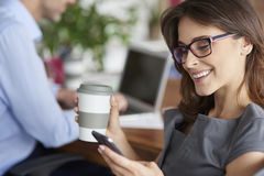 Business team. Drinking coffee and using mobilephone Stock Images