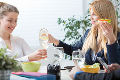 Business team eating lunch. Horizontal view of business team eating lunch stock photo