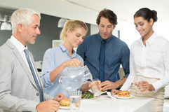 Business team enjoying lunch stock photography