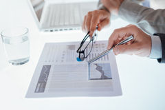 Business team examining a financial report Royalty Free Stock Image