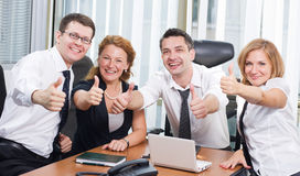 Business team express positivity. On meetingin board room in Hi Res royalty free stock photo