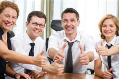 Business team express positivity on meeting. In board room stock images