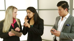 Business team in fast paced business dealings Stock Image