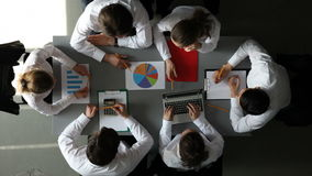 Business team with financial reports. Team of business people working with papers and financial reports