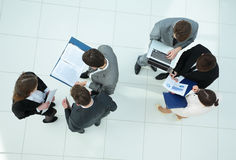 Business team with financial schedules,documents and laptop in t Stock Photos