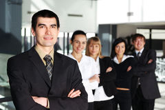 A business team of five persons in a modern office Royalty Free Stock Image