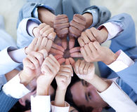 Business team on floor in a circle with thumbs up Royalty Free Stock Photography