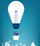 Business team flying in the sky on hot air balloon. Looking over. Mountain peaks. Concept business illustration. Vector flat Royalty Free Stock Photo