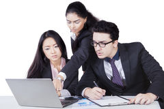 Business team focus with laptop Stock Photos