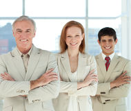 Business team with folded arms in a line Stock Image