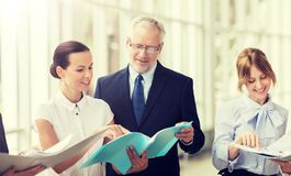 Business team with folders meeting at office royalty free stock photos