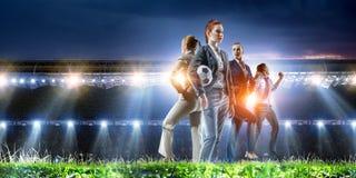 Business team on football stadium. Mixed media royalty free stock image