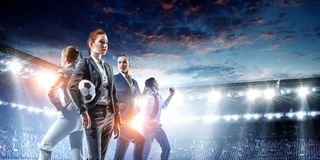 Business team on football stadium. Mixed media royalty free stock images