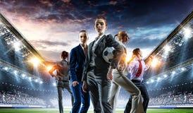 Business team on football stadium. Mixed media stock photos