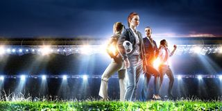 Business team on football stadium. Mixed media stock photography