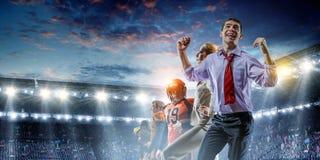Business team on football stadium. Mixed media royalty free stock photography