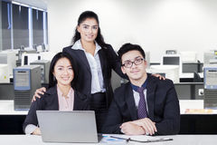 Business team with formal suit smiling in the office Stock Photography