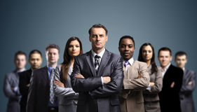Business team formed of young businessmen Stock Photos