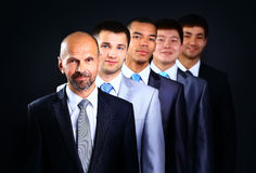 Business team formed of young businessmen Royalty Free Stock Images