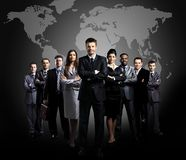 Business team formed of young businessmen standing over a dark background Stock Images