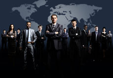 Business team formed. Of young businessmen standing over a dark background stock images