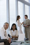 Business team of four Stock Photo