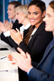 Business team of four applauding. Business people applauding in a meeting Royalty Free Stock Images