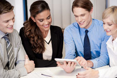 Business team of four enjoying work Stock Images
