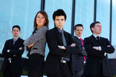 A business team of four persons in formal clothes Stock Photo