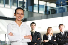 A business team of four persons in a modern office Stock Images