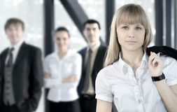 A business team of four persons in a modern office Royalty Free Stock Photography