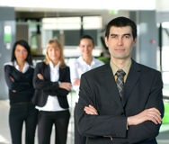 A business team of four persons in a modern office Stock Photography