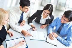 A business team of four plan work Stock Image