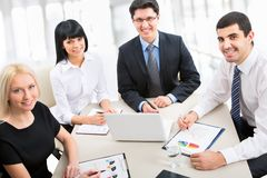 A business team. Of four plan work in office Royalty Free Stock Photos