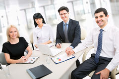 A business team. Of four plan work in office Stock Photo